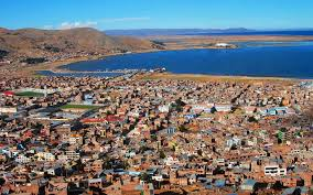 Urban sprawl of Puno and the harbor on Lake Titicaca. Puno, Peru Tourism Bureau, 2014